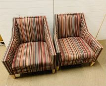 A pair of contemporary armchairs with striped upholstery