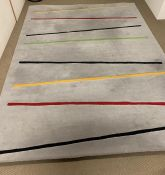 A grey thick pile rug, with strips of colour (300cm x 225cm)
