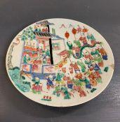 An oriental decorative plate depicting a celebration parade