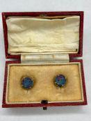 A Pair of Fire Opal Earrings in 9ct gold settings.