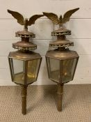 A pair of 19th century brass and copper carriage/buggy candle lamps with eagles finals
