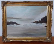 An oil on canvas depicting a seascape, signed and framed.