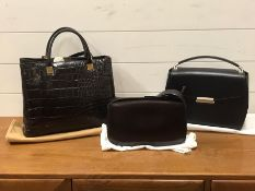 Three designer bags by Coccinelle, Nina Ricci and Mandarina Duck, all with dust covers and clean