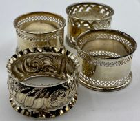 A Selection of four hallmarked silver napkin rings, various makers and hallmarks.