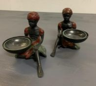 A pair of native women holding baskets/dishes
