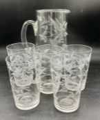 A water jug and five glasses with a bird and fern etching