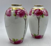 A pair of Cacilie vases decorated with roses
