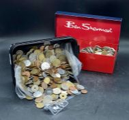 A large quantity of foreign coins (about three kilos)