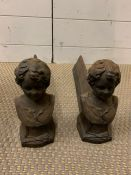 A Pair of Cherub themed Fire Dogs in cast iron.