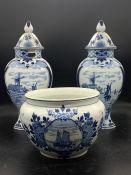A Delft Garniture set (AF) comprising a bowl and two lidded vase