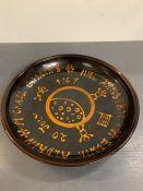 "A studio pottery glazed dish depicting ""The Moon Landing"""