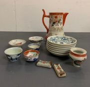 A selection of oriental tea bowls, plates and jug
