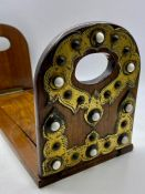 An Antique brass book slide with cabochons
