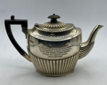 A Hallmarked silver teapot (448g) engraved and dated Sheffield 1895, makers mark James Deakin and