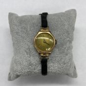 A 9ct gold ladies watch (Approx weight 8g)