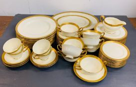 A Royal Doulton bone china part dinner service with gilt rim edge to include, serving dishes, eleven