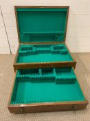 A Mahogany cutlery box lined with green baize.