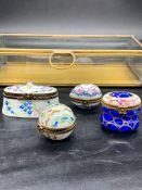 A group of four small Limoges hand painted porcelain trinket boxes, together with a rectangular