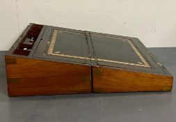 A Mahogany, brass banded writing slope with black leather inlay.