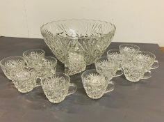 A cut glass punch bowl and twelve cut glass cups