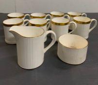 "Eight ""Golden Glory"" fine bone Crown china coffee cans, milk jug and sugar bowl"