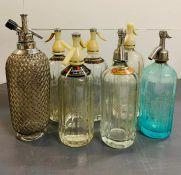 Seven vintage soda siphons
