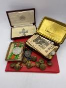 A Selection of Military ephemera to include a 1916 Christmas Tin, replica military cross, Defence