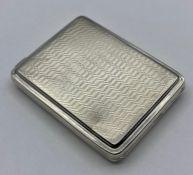 A Machine tooled silver card case Adie Brothers Ltd, hallmarked Birmingham 1928.