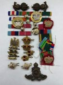A Selection of Military insignias, buttons and medal bars, with a Royal Artillery background.
