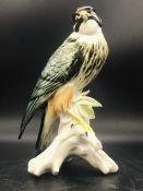 A Porcelain figure of a Hawk.