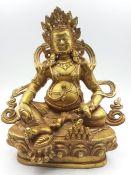 A Tibetan gilt bronze of god of wealth Jambhala, (20.5 cm high). Provenance: From the Sidhu Family