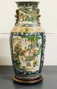 A large vase of slightly ribbed baluster form and folded rim with 'Famille verte' enamelled
