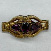 An untested three stone brooch.