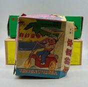 Three boxed clockwork/wind-up tin toys