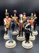 Eight porcelain model army figures