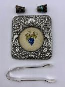 A mixed selection of silver items to include frame front, thimbles, small tongs etc.