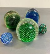 Five vintage glass paper weights