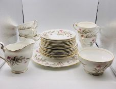 A part Royal Standard tea service to include, six cups, eight saucers, eight side plates, cake