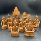 Twelve carved wood figures