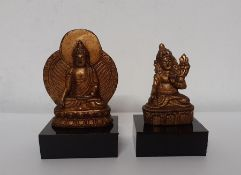 A pair of little metal gilded figures, (7x15 cm largest). Provenance: From the Sidhu Family