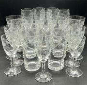 A collection of glassware etched with a bamboo design