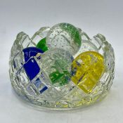A selection of six glass bubble balls in various colours.