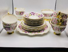 """A part Royal Strafford tea service """"Clematis"""" to include, Five cups and six saucers, five side"""