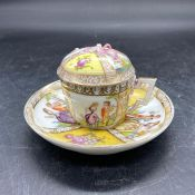 A Dresden chocolate cup with lid and saucer.