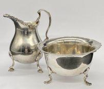 A Silver milk jug (Birmingham) and sugar bowl (Chester) hallmarked.
