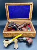 A selection of vintage smoking pipes various makers to include Peterson in a carved wooden box