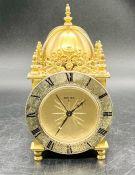 A rare Vintage brass Swiza eight day travel alarm clock, Swiss made.