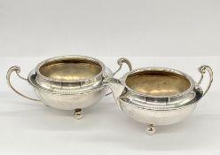 An Art Deco silver sugar bowl and milk jug, hallmarked for Birmingham 1915