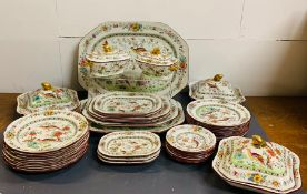A Copeland Spode dinner service with birds of paradise decoration