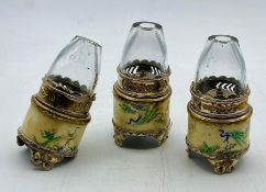 Three Chinese white metal and ivory candles or lights
